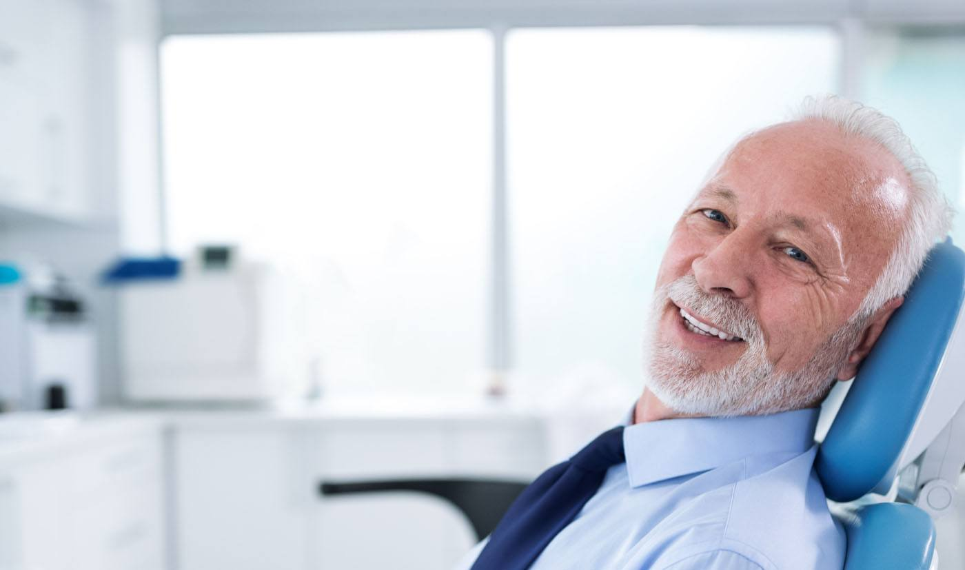 man with beard smiling in exam chair