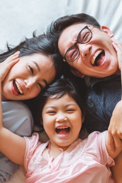 family of three laughing