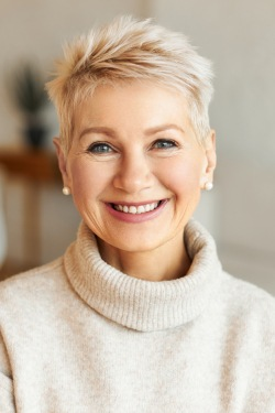 woman wearing sweater smiling